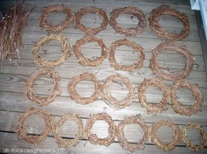 the end result was 19 wreaths in sizes from 7 1/2″ to 15″ across. The pile of sticks on the left will be used for twig swags