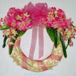 pink straw wreath with hyacinths and tweedia