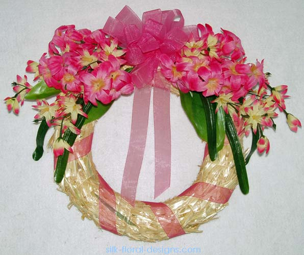 straw wreath in pinks