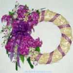 straw wreath with purple hyacinths and tweedia silk flowers
