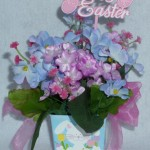 small blue box arrangement with purple and blue silk flowers