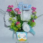 mini blue box design with white crocus, green daisies and pink silk flowers