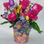 metal pail decorated for Easter, filled with spring flowers