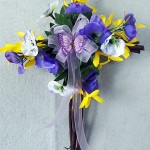 Spring grapevine cross decorated with pansies and forsythia
