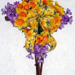 grapevine cross decorated for spring with daffodils and hyacinths