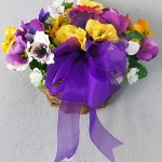 vine wall pocket basket for spring filled with pansies