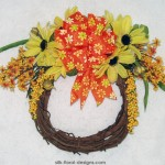 Summer grapevine wreath with black-eyed susans, bittersweet and berries